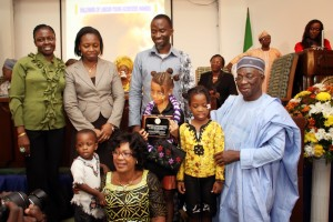 MISS-ONARIETTA-ISABELLA-REMET-RECIEVING-AWARD-AS-ONE-OF-AFRICAS-YOUNGEST-EXHIBITING-ARTISTS-FROM-CHIEF-PHILLIP-ASIODU-MRS-PATRICIA-OTUEDON-ARAWORE-AND-THE-REMET-FAMILY