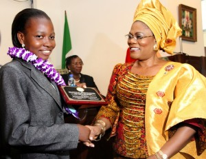 NIGERIAS-BEST-STUDENT-IN-WASSCE-2011-MISS-CHRISTIANAH-ADELOYE-RECIEVING-PLAQUE-FROM-OTUNBA-GRACE-LAOYE-TOMORI