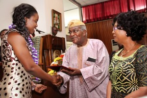 NIGERIAS-FIRST-YOUNGEST-PH.D-RECIEPIENT-DR.-TEMITOPE-ADEYEMI-RECIEVING-PLAQUE-FROM-BRIGADIER-MOBOLAJI-JOHNSON-AND-THE-CONVEYNER