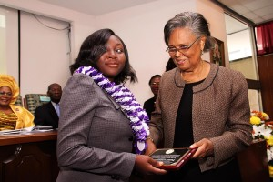NIGERIAS-YOUNGEST-PH.D-RECIEPENT-DR.-OPEYEMI-SODIPE-RECIEVING-PLAQUE-FROM-PROFESSOR-GRACE-ALELE-WILLIAMS-