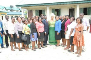 Mrs. Pat Arawore with the Principal, Mr. Emmanuel Oleju and other members of staff, Egbokodo Secondary School