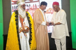 Professor Galadanci receiving his award from HE Dr.  Ogbonnaya Onu while the representative Emir of Kano watches on