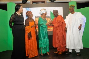 Professor Gambari presenting an award to Professor Joy Ogwu while Professor Akinkugbe, Mrs Francesca Emanuel Chief Patricia Otuedon-Arawore  watches on
